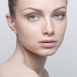 Portrait of beautiful young woman with clean and healthy face. Natural Make up